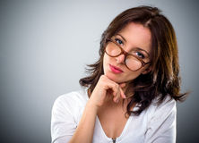 Thoughtful attractive woman wearing glasses Royalty Free Stock Image