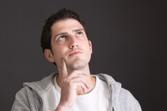 Thoughtful attractive young man - portrait Royalty Free Stock Photos