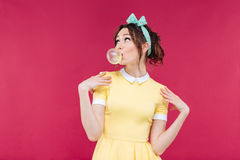 Thoughtful attractive young woman blowing bubble from chewing gum Stock Images