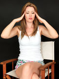 Thoughtful Attractive Young Woman with Headache looking Stressed Royalty Free Stock Image