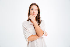 Thoughtful attractive young woman thinking and looking away Stock Photo
