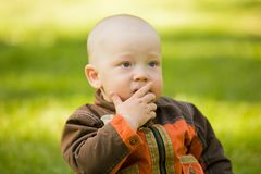 Thoughtful baby Stock Images