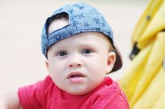 Thoughtful baby on baby carriage. Thoughtful baby age of 10 months on baby carriage Stock Image