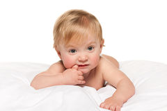 Thoughtful baby boy in the bed Stock Images