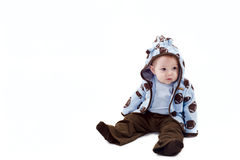 Thoughtful baby boy dressed blue hoodie Royalty Free Stock Photography