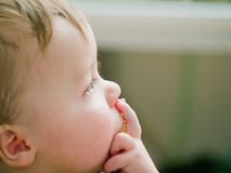 Thoughtful baby boy thinking about copyspace Royalty Free Stock Photography