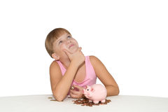 Thoughtful  baby girl with piggy bank isolated Royalty Free Stock Photo