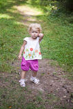 Thoughtful  baby goes on a footpath Stock Images