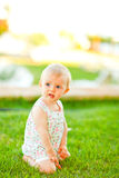 Thoughtful baby playing on grass Royalty Free Stock Photography