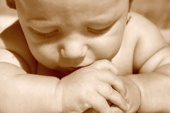 Thoughtful baby portrait Royalty Free Stock Images