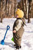 Thoughtful baby with shovels Stock Photography