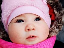 Thoughtful baby in the winter stock image