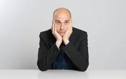 Thoughtful bald businessman Royalty Free Stock Image