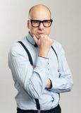 Thoughtful bald man in glasses Stock Image