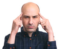 Thoughtful bald man thinking. Serious guy having headache. Isolated Stock Photos
