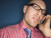 Thoughtful Bald Man Using Cellphone Royalty Free Stock Photography