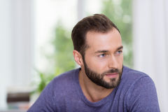 Thoughtful bearded man looking off to the right Royalty Free Stock Photo