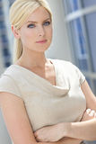 Thoughtful Beautiful Blond Woman In Her Thirties. Natural light portrait of a beautiful thoughtful blond woman in her thirties with blue eyes Stock Photo