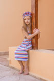 Thoughtful beautiful girl in striped dress Stock Images