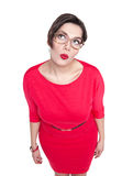 Thoughtful beautiful plus size woman in glasses looking on somet Royalty Free Stock Images