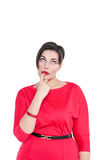 Thoughtful beautiful plus size woman looking on something up Stock Photo