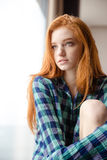 Thoughtful beautiful redhead lady looking away Royalty Free Stock Photography