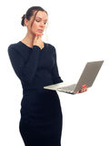 Thoughtful beautiful woman holding a laptop. Isolated over white background Royalty Free Stock Images