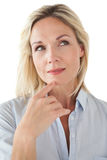 Thoughtful beautiful woman looking away. Over white background Stock Images