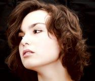 Thoughtful beautiful woman portrait. On black background Royalty Free Stock Photo