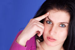 Thoughtful and beautiful woman, remember something Royalty Free Stock Image