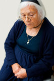 Thoughtful believer woman. Thoughtful elderly believer woman portrait sitting and looking to distance stock photos