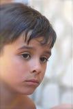 Thoughtful, Big Eyes. Thoughtful little boy with sad expression Stock Photography
