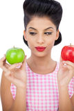 Thoughtful black hair model holding apples Royalty Free Stock Images