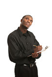 Thoughtful Black Man Holding Clipboard Stock Images