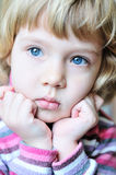 Thoughtful blonde child Royalty Free Stock Photo