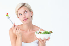 Thoughtful blonde eating salad Stock Photos