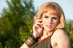 Thoughtful blonde girl in a blouse of khaki Stock Images
