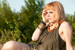 Thoughtful blonde girl in a blouse of khaki Stock Photography