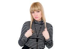 Thoughtful blonde with the hair twirled Stock Images