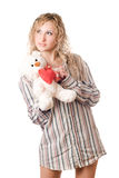 Thoughtful blonde holding teddy bear Stock Photos