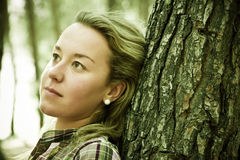 Thoughtful Blonde In Forest Stock Photography