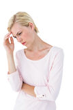 Thoughtful blonde woman. On white background royalty free stock photo