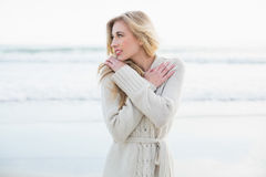 Thoughtful blonde woman in wool cardigan looking away Royalty Free Stock Image