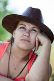 Thoughtful boring Caucasian woman in cowboy hat Royalty Free Stock Images