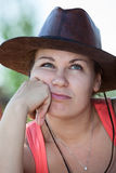 Thoughtful boring woman in cowboy hat Royalty Free Stock Photography
