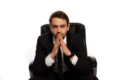 Thoughtful boss sitting at his desk Royalty Free Stock Photo