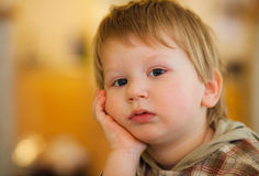 Thoughtful boy Stock Images