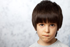 Thoughtful boy bit his lip Royalty Free Stock Photography