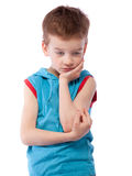 Thoughtful boy in blue shirt Royalty Free Stock Image