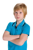 Thoughtful boy in a blue shirt Stock Photos
